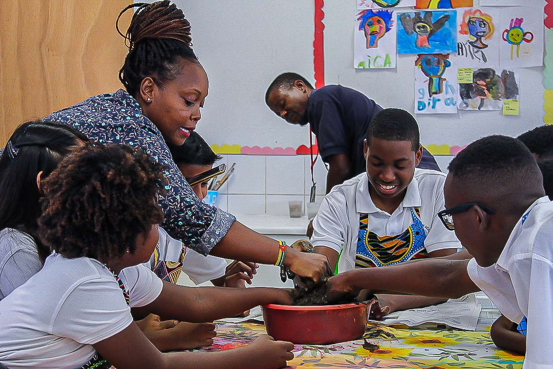 Ensuring students understand the local cultures and traditions in Maputo, Rosa conducts mask making classes as a way of self-expression for her students.