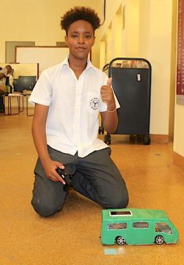 Mahamed Abdi (Year 10) presenting a hybrid model of electric and solar powered Matatu