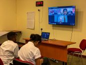 Year 8 students engaging in a video conference with students from India.