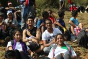 Students rest at the peak after their tough climb