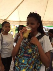 Enjoying a glass of sugarcane juice