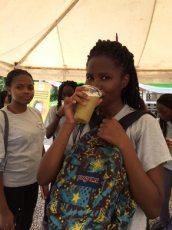 Enjoying a glass of sugarcane juice