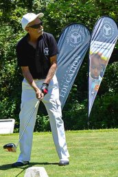 Shiraz Alibhai playing golf at the golf tournament.