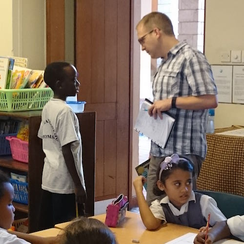 Andrew with a student