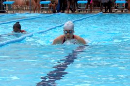 Students competing in 200m breastroke race