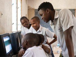 Raphael Mwachiti teaching kids computer skills