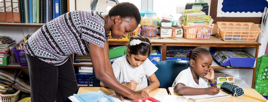 Junior School teacher with student