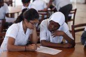 Students from Aga Khan Academy Mombasa and Mbaraki Girls High School work collaboratively on an activity